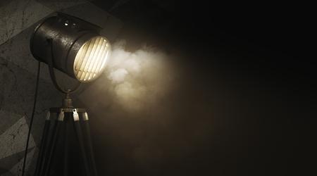 Gloeiende schijnwerper tegen abstracte grungemuur met rook en exemplaarruimte. Apparatuur concept. 3D Rendeirng