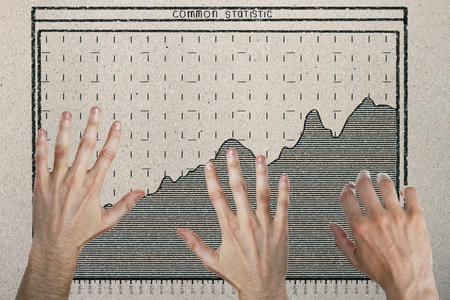 Abstract image of hands with drawn business chart on concrete background. Teamwork and economy concept  Reklamní fotografie