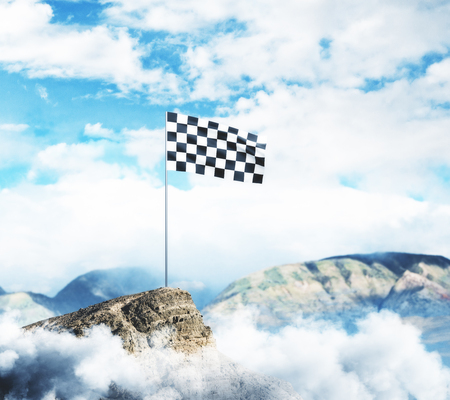 Checkered flag on mountain top. Cloudy sky background. Leadership concept