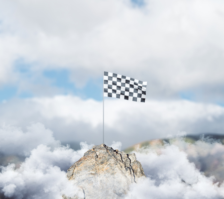 Checkered flag on mountain top. Cloudy sky background. Victory concept Stok Fotoğraf - 89432259