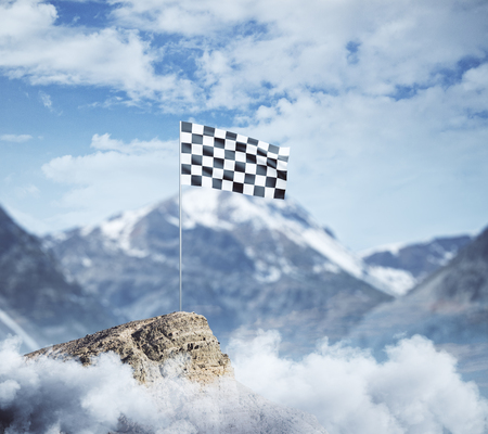 Checkered flag on mountain top. Cloudy sky background. Success concept