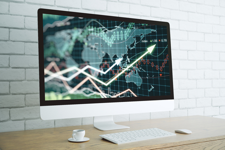 Creative designer desktop with forex chart on computer screen, coffee cup, and other items. White brick wall backdrop. Finance concept. 3D Rendering Stock Photo
