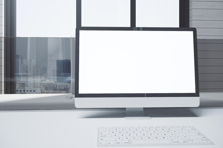 Close up of creative designer desktop with blank white pc screen and keyboard. City view and sunlight background. Mock up, 3D Rendering