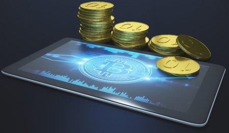 e business: Close up of tablet with business chart and golden bitcoins on dark background. E-commerce and payment concept. 3D Rendering
