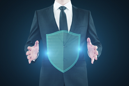 Businessman holding glowing antivirus shield on blue background. Safety and hack concept. 3D Rendering