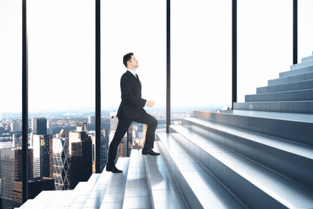 Side view of businessman climbing stair in interior with panoramic city view. Growth and career concept. 3D Rendering