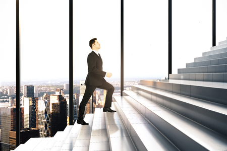 Side view of businessman climbing stair in interior with panoramic city view. Success and promotion concept. 3D Rendering