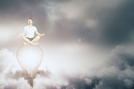 Meditating man sitting on abstract lamp. Cloudy sky background. Innovation and peace concept. 3D Rendering  Stock fotó
