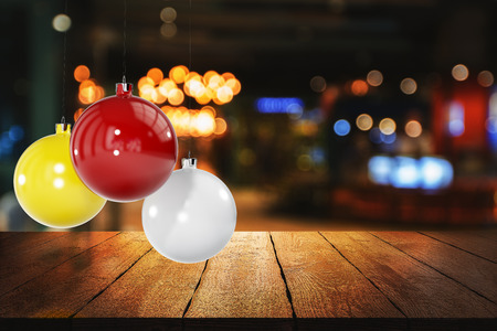 Colorful christmas balls on blurry backdrop with wooden surface. Celebration, New Year concept. 3D Rendering
