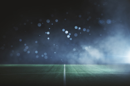 Abstract football field at night. Creative background Stock Photo
