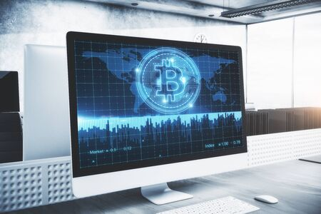 Close up of computer monitor with bitcoin map on screen placed in modern concrete office. Banking and currency concept. 3D Rendering Stock Photo