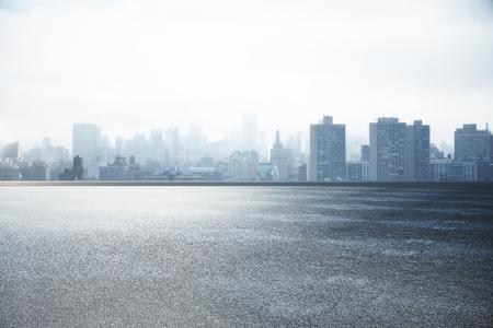 Resumen asfalto y papel tapiz del horizonte de la ciudad