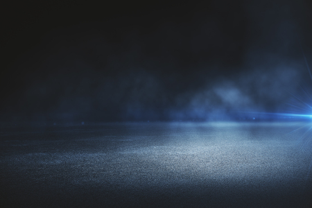 Creative blurry outdoor asphalt background with mist