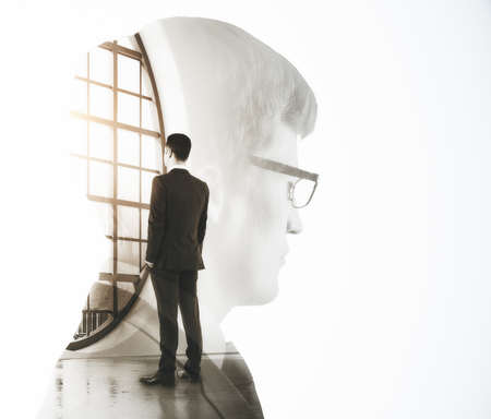 Abstract image of businessman thinking in modern interior with city view. Research and work concept. Double exposure