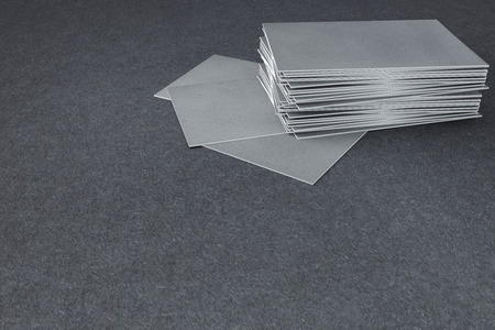 Close up of empty businessvisiting cards on textured concrete background. Mock up, 3D Rendering  Stock Photo