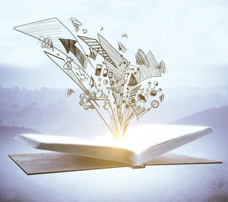 Open boek met zakelijke schets op wazige mistige achtergrond. Onderwijs en succes concept