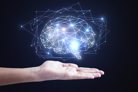 Hand holding abstract glowing polygonal brain on dark background. Artificial intelligence and network concept. 3D Rendering