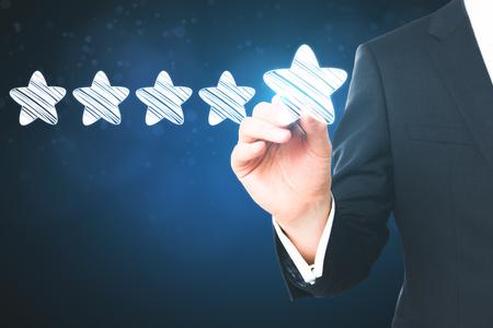Hand drawing glowing stars. Leadership and success concept 版權商用圖片