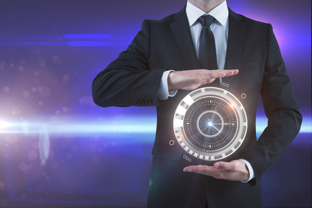 Man holding abstract digital clock dial on blurry background. Time concept