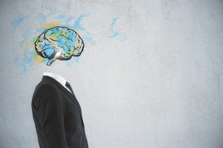 Brain headed businessman standing on dark background with copy space. Brainstorm and intelligence concept  Stock fotó
