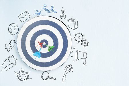 Dartboard on concrete background with sketch. Targeting and leadership concept. 3D Rendering