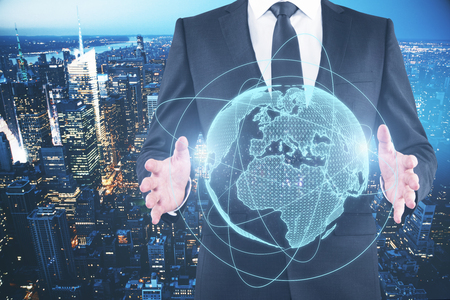 Businessman holding glowing planet on blue background. Global business concept. Double exposure   Stok Fotoğraf