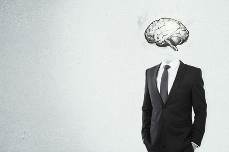 Brain headed businessman standing on dark background with copy space. Brainstorm and mind concept