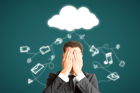 Businessman covering face on abstract background with cloud and media sketch. Cloud computing and network concept  Stock fotó