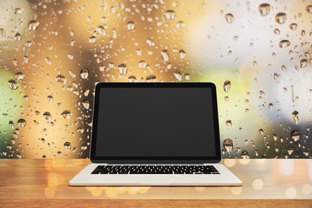 Close up of empty laptop on blurry rain background. Mock up, 3D Rendering  Stock Photo