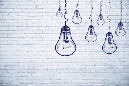 Creative lamp sketch on brick wall background. Idea, innovation and achievement concept