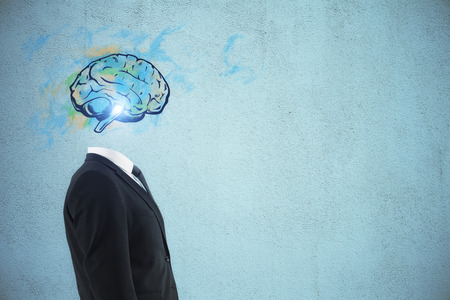 Brain headed businessman standing on dark background with copy space. Brainstorm and success concept