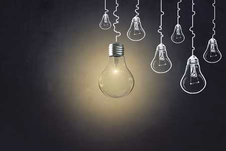 Creative lamp sketch on concrete wall background. Idea, innovation and plan concept