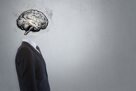 Brain headed businessman standing on dark background with copy space. Brainstorm and intellect concept  Stock Photo