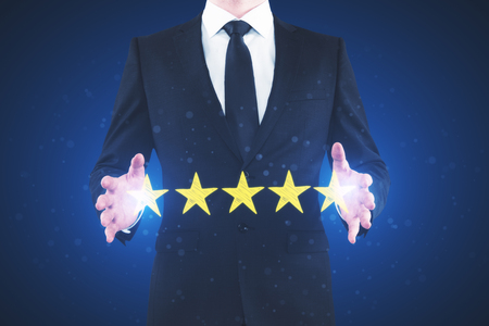 Businessman rating hotel on blurry background. Performance and quality concept Stok Fotoğraf - 95902502