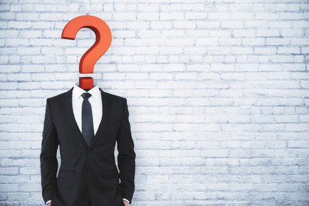 Question mark sketch headed businessman on brick background with copy space. Confusion and answer concept  Stock Photo