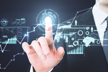 Close up of businessman hand pointing at abstract digital business interface. Future and analytics concept. Double exposure