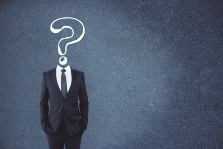 Question mark sketch headed businessman on concrete background with copy space. Confusion and faq concept