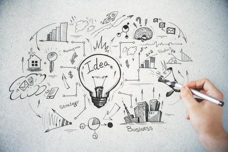 Hand tekening business schets op lichte concrete achtergrond. Brainstorm en financieel concept