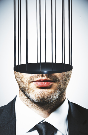 Abstract image of prison bar headed man. Freedom and stereotype concept