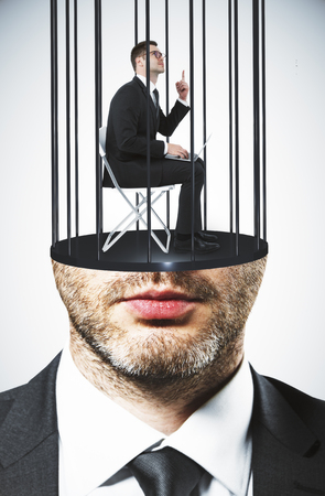 Abstract image of prison bar headed executive. Freedom and stereotype concept