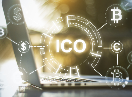 Close up of notebook with abstract ICO hologram. Initial coin offering concept. Double exposure