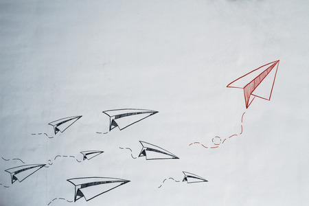 Concrete backdrop with drawn paper planes. Leadership and startup concept
