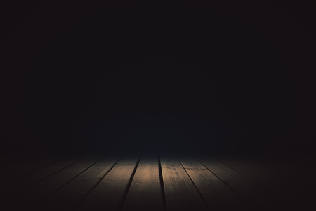 Abstract dark background with spotlight. Presentation concept