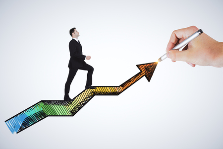 Businessman climbing drawn arrow on white background. Success and financial growth concept Stock Photo