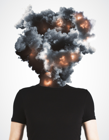 Man with abstract explosion smoke and fire head standing on white background. Disaster and stress concept