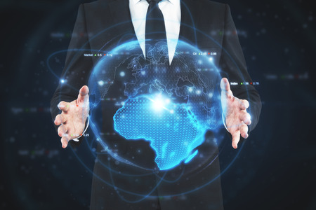 Businessman hands holding glowing digital globe on dark background. International business and network concept. Double exposure