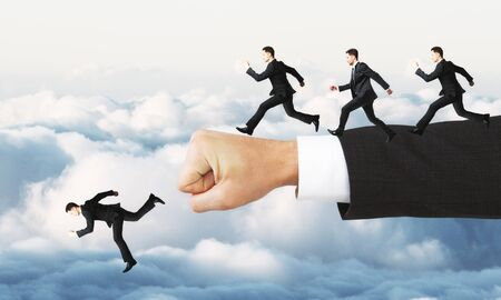Businessmen running off hand on abstract sky background. Risk concept