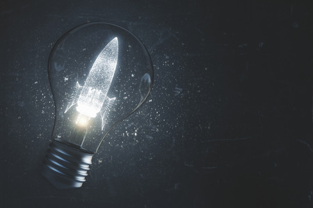 Abstract glowing lamp with drawn space ship. Startup and entrepreneurship backdrop. 3D Rendering  写真素材