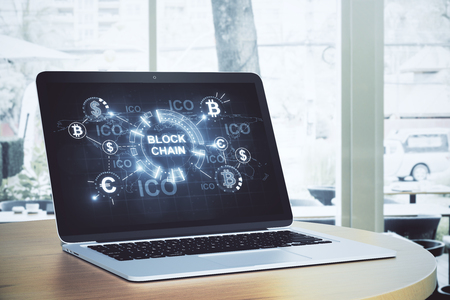 Laptop with blockchain on screen. Blurry background. Cryptocurrency concept. 3D Rendering  Stock Photo