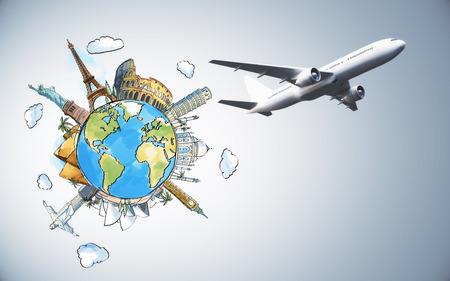 灰色の背景にカラフルなグローブスケッチを持つ飛行機。旅行と観光のコンセプト 写真素材